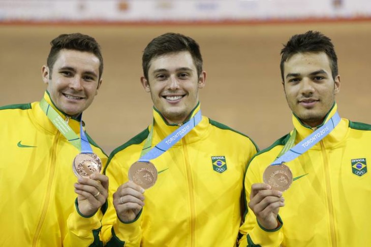 Brazil's Flavio Cipriano, left, Hugo Osteti, center, and Kacio Freitas pose for photos with their bronze medals earned during the men's sprint track cycling competition at the Pan Am Games in Milton, Ontario, Thursday, July 16, 2015. (AP Photo/Felipe Dana)