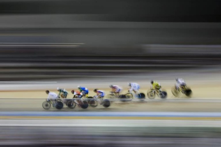 Cyclists pedal during the men's omnium elimination track cycling competition at the Pan Am Games in Milton, Ontario, Thursday, July 16, 2015. (AP Photo/Felipe Dana)