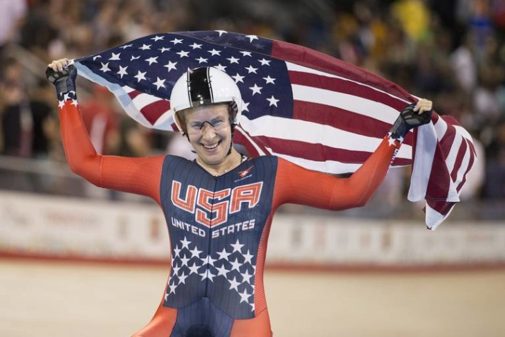 United States Sarah Hammer celebrates winning gold in the women's omnium points race during track cycling at the Pan Am games in Milton, Ont., on Sunday, July 19, 2015. THE CANADIAN PRESS/Chris Young